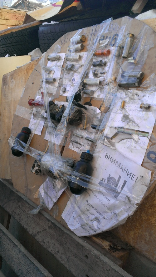 Remains of weapons used against the Ukrainian protesters on the Maidan: rubber and metal bullets, concussion and stun grenades wrapped in shrapnel-to-be, and skin-splitting rounds for maximum blood loss.