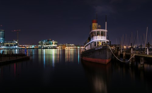 Baltimore harbor at night. Photo by Bob Burkhard on Unsplash.