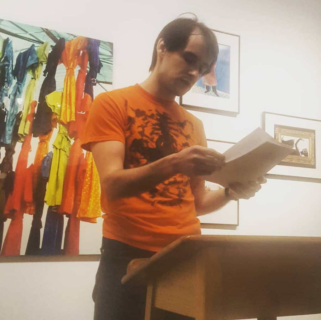 Me reading at The Racket reading series on February 20, 2020 at Alley Cat Books, San Francisco.